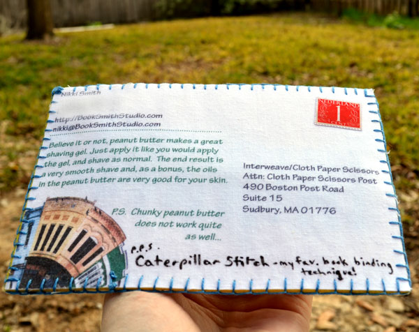 Back of caterpillar stitch fabric postcard by Nikki Smith