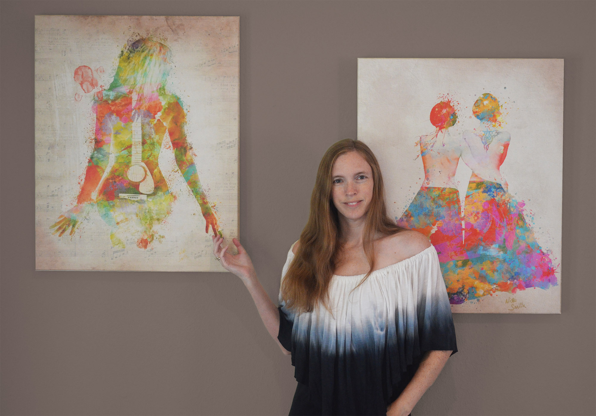 "Artist Nikki Smith with her self-portrait ""Music Was My First Love"" and painting ""Pride Not Prejudice"""