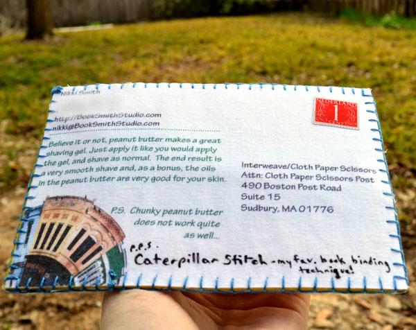 Back of caterpillar stitch fabric postcard by Nikki Smith